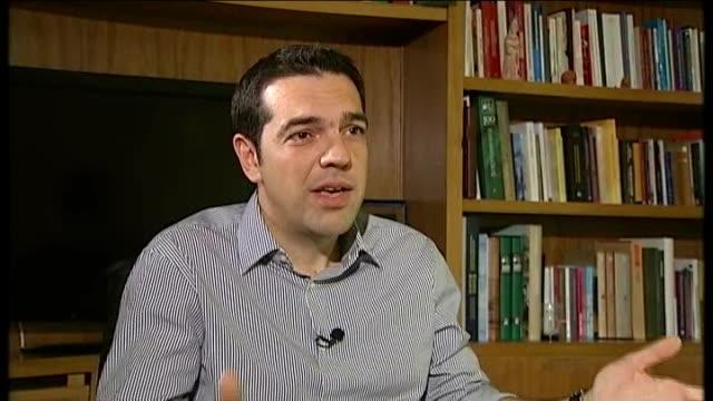 vídeos y material grabado en eventos de stock de alexis tsipras interview; greece: athens: tsipras in party offices and along with rugman for interview alexis tsipras interview sot - don't think... - devaluation
