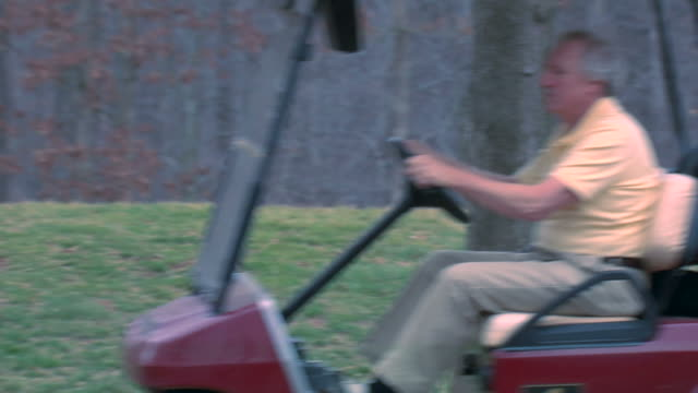 alex's golf cart - panning right to left - golf cart stock videos & royalty-free footage