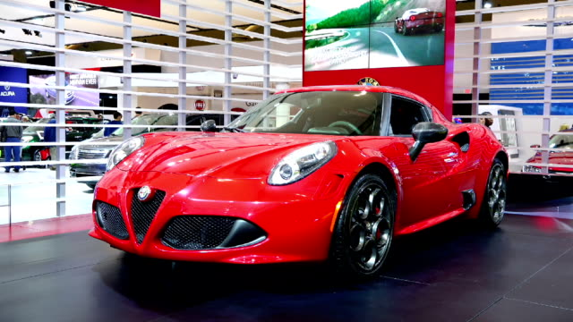 alfa romeo in the canadian international autoshow which is canada's largest automotive show held annually at the metro toronto convention centre - strategia di vendita video stock e b–roll