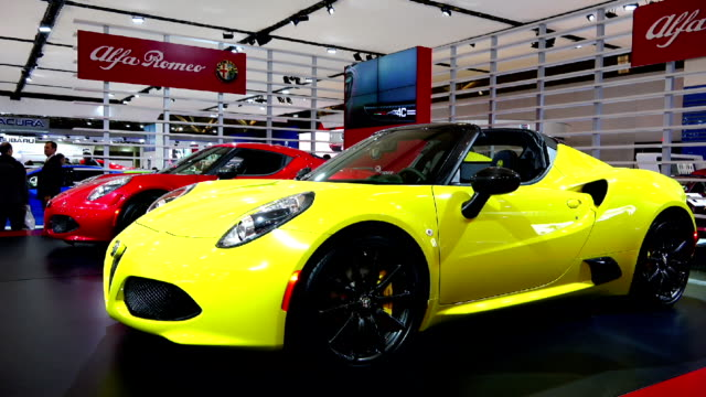 alfa romeo in the canadian international autoshow which is canada's largest automotive show held annually at the metro toronto convention centre. - verkaufsargument stock-videos und b-roll-filmmaterial