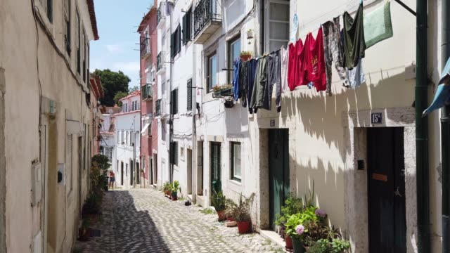 alfama alley, lisbon, portugal - portugal stock videos & royalty-free footage