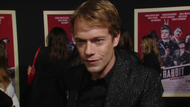 """interview alfie allen on his character and the production at the """"jojo rabbit"""" los angeles premiere presented by fox searchlight pictures in los... - fox searchlight pictures stock videos & royalty-free footage"""