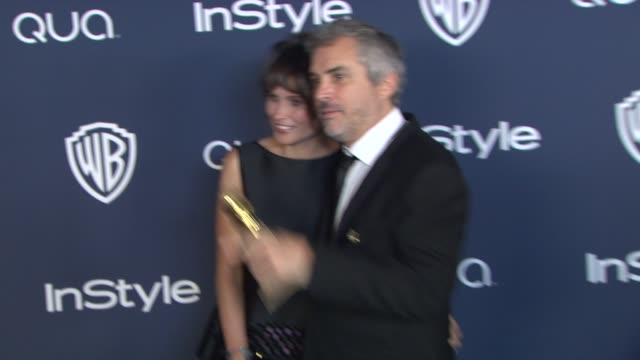 Alfonso CuaronS and heherazade Goldsmith at 2014 InStyle And Warner Bros 71st Annual Golden Globe Awards PostParty at The Beverly Hilton Hotel on in...