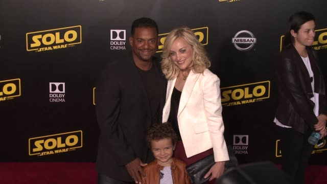 Alfonso Ribeiro and Angela Unkrich at the 'Solo A Star Wars Story' World Premiere at the El Capitan Theatre on May 10 2018 in Hollywood California