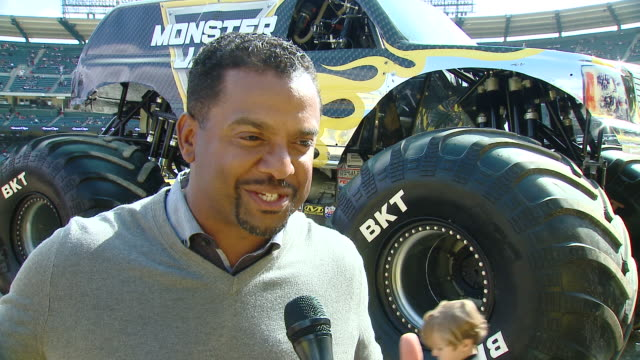 alfonso ribeiro on tell us who are you here with today and what are you looking forward to seeing at monster jam, on which truck is your favorite and... - angel stadium stock videos & royalty-free footage