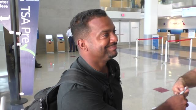 Alfonso Ribeiro refuses to talk about Donald Trump's cameo on Fresh Prince Of Bel Air while departing at LAX Airport in Los Angeles in Celebrity...