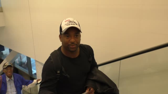 INTERVIEW Alfonso Ribeiro talks about racing cars while departing at LAX Airport in Los Angeles in Celebrity Sightings in Los Angeles