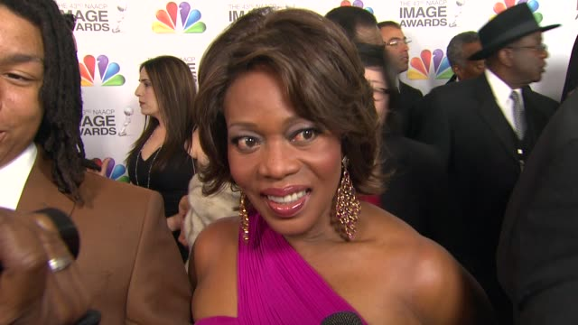 alfre woodard on the event at the 43rd naacp image awards - arrivals on 2/17/12 in los angeles, ca - アルフレ・ウッダード点の映像素材/bロール