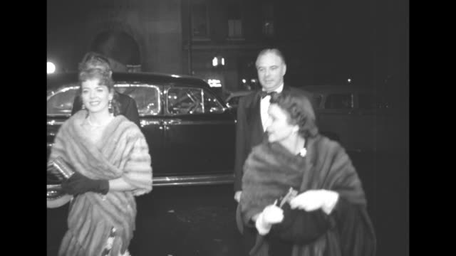 Alfred Schwalberg Hugh Owens and wives arrive at venue / Judy Garland greets wellwisher and is joined by husband Sid Luft / Tilt down people entering...