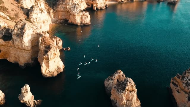 algarve, aerial view of coastline and ocean. portugal - portugal stock-videos und b-roll-filmmaterial
