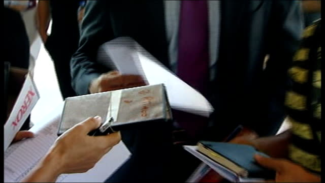 Algarve Praia da Luz EXT Pages of police evidence files being flicked through DVDs containing police evidence from McCann investigation being handed...