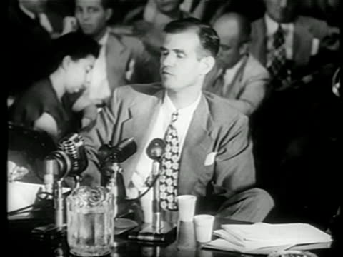 alger hiss sitting testifying at house committee on unamerican activities trials / news - house committee on unamerican activities stock videos & royalty-free footage