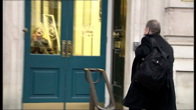 cobra meeting arrivals england london whitehall ext various shots of unidentified people arriving at cabinet office - アルジェリア人質事件点の映像素材/bロール