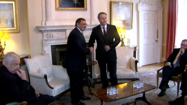 further british workers feared dead lib / tx downing street david cameron mp shaking hands with leon panetta - アルジェリア人質事件点の映像素材/bロール