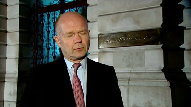 further british workers feared dead england london william hague mp walking along from foreign office william hague mp interview sot we believe that... - アルジェリア人質事件点の映像素材/bロール