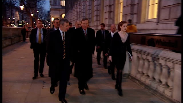 fears for safety of hostages after troops storm gas facility england london unidentified people arriving at cabinet office for cobra emergency meeting - アルジェリア人質事件点の映像素材/bロール