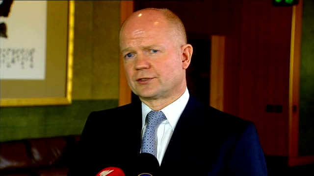 fears for safety of hostages after troops storm gas facility england london william hague mp interview sot convenient excuse to quote but usually... - アルジェリア人質事件点の映像素材/bロール
