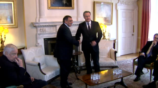 some hostages freed 10 downing street david cameron photocall and handshake with leon panetta at downing street meeting - アルジェリア人質事件点の映像素材/bロール