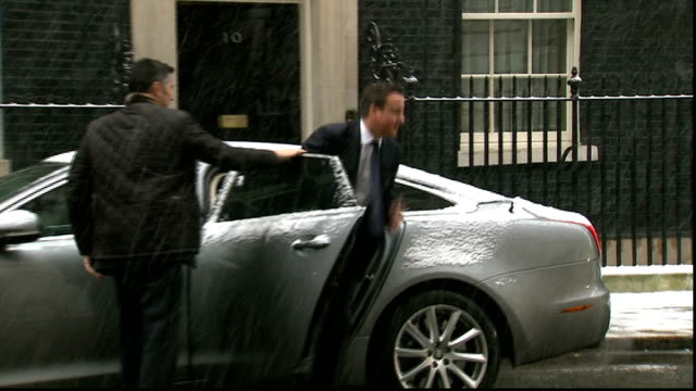 some hostages freed downing street david cameron out of car and along into number 10 - アルジェリア人質事件点の映像素材/bロール
