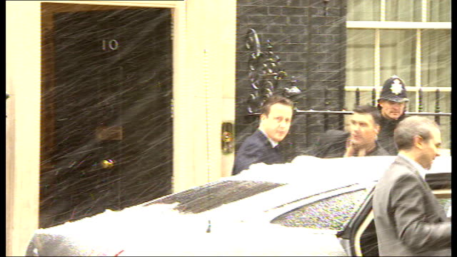 some hostages freed england london downing street david cameron mp from number 10 in heavy snow and into car - アルジェリア人質事件点の映像素材/bロール