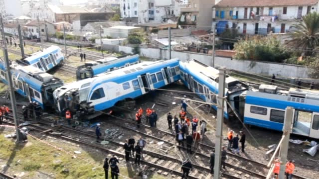 algerian officials are seen during search and rescue operations held for the train crash in which a person died and 57 other people get wounded in... - train crash stock videos and b-roll footage