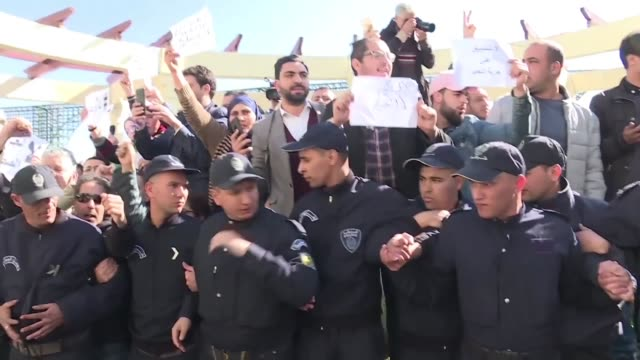 algerian police arrest journalists participating in a rally against alleged censorship of coverage of protests against a fifth term for veteran... - censorship stock videos & royalty-free footage