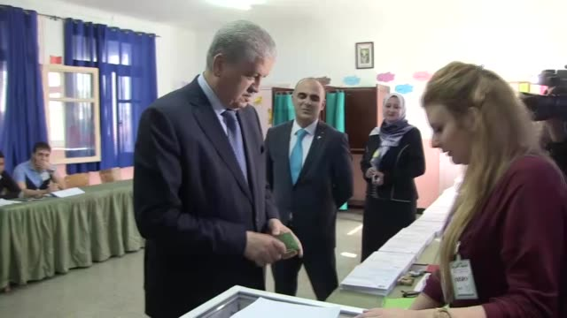 Algerian Prime Minister Abdelmalek Sellal casts his vote at a polling station during parliamentary elections in Algiers Algeria on May 04 2017