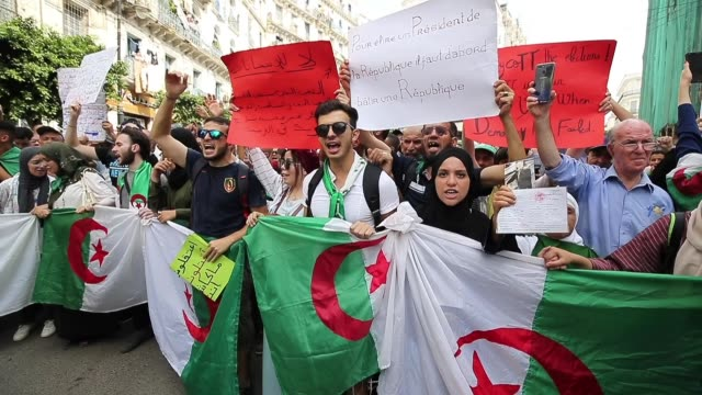 algerian protesters carrying national flags chant slogans during a students' demonstration against postponing the presidential elections in algiers... - 12 17 mesi video stock e b–roll