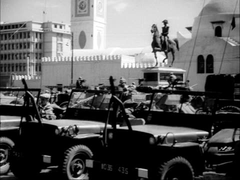 failed revolt French paratroopers in Algiers ALGERIA Algiers EXT High angle view street scene PAN army vehicles parked Armoured military vehicles...
