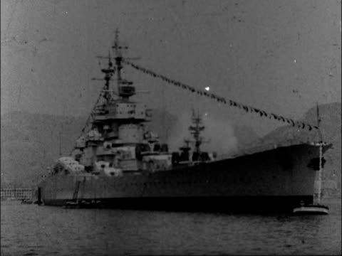 french fleet sails for the south from toulon; tx 15.7.1958 france: toulon: ext battle ships at anchor battle ship at buoy aerial deck of battleship... - battleship stock videos & royalty-free footage