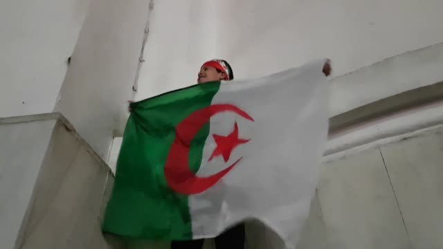 algerians celebrate after the resignation of president abdelaziz bouteflika on april 02 2019 in algiers algeria following over a month of protests of... - アルジェリア点の映像素材/bロール