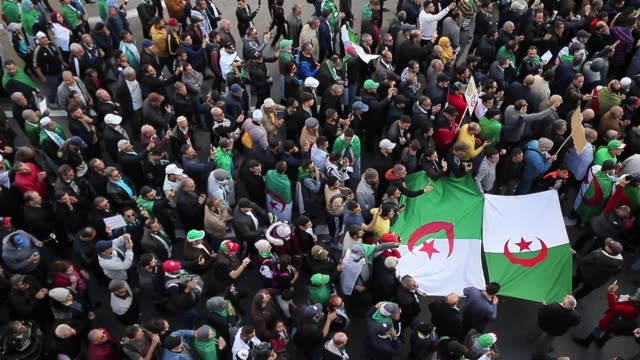 algerians chant slogans as they march during an antigovernment demonstration in the algerian capital algiers on december 6 ahead of the presidential... - アルジェリア点の映像素材/bロール