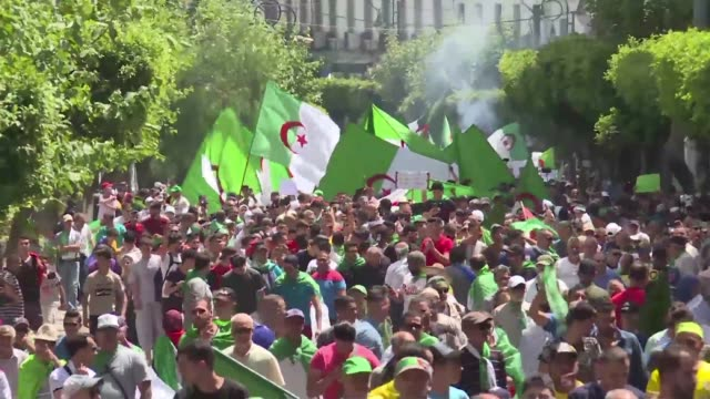 algerians rally for the 17th consecutive friday in the capital algiers to keep up their demands for the ouster of all officials linked to the former... - former stock videos and b-roll footage