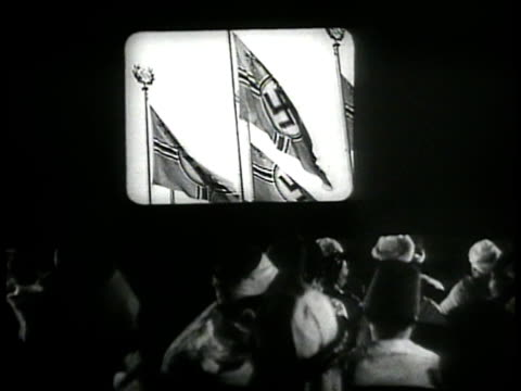 ws algerians watching theatre screen film clapping of italian dictator benito mussolini nazi swastika flags german's adolf hitler w/ aides world war... - nazi swastika stock videos and b-roll footage