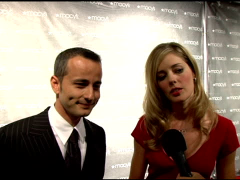 Ali Afshar and Christina Moore on what brought them out tonight at the Macy's Passport 2005 Presented by American Express at Barker Hanger in Santa...