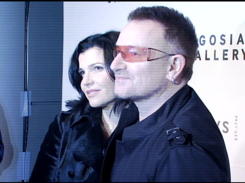 Ali Hewson and Bono at the Bono and Damien Hirst Paint the Town Red For Aids In Africa The Auction at Sotheby's in New York New York on February 14...