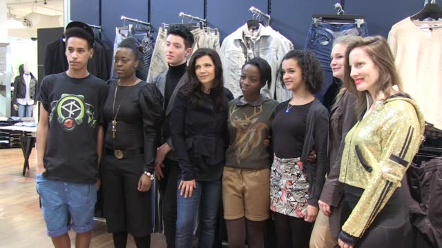 Ali Hewson poses with college students at the launch of her new range of EDUN clothing EDUN Clothing Ali Hewson at Selfridges on February 26 2011 in...