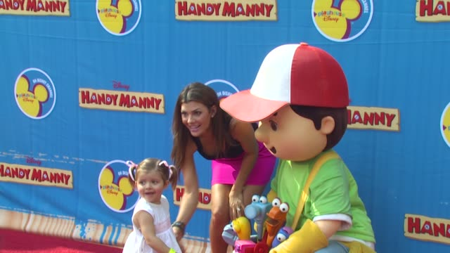 Ali Landry and daughter Estela with Handy Manny at the Exclusive Premiere of Disney Channel's 'Handy Manny Motorcycle Adventure' at Hollywood CA