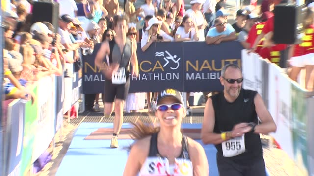 Ali Landry arrives at finish line at 26th Annual Nautica Malibu Triathlon on 9/16/12 in Malibu CA
