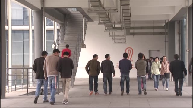 'Alibaba campus in Hangzhou China on November 19 Wide shot of campus and people walking around Wide shot of concierge and groups sitting in a common...