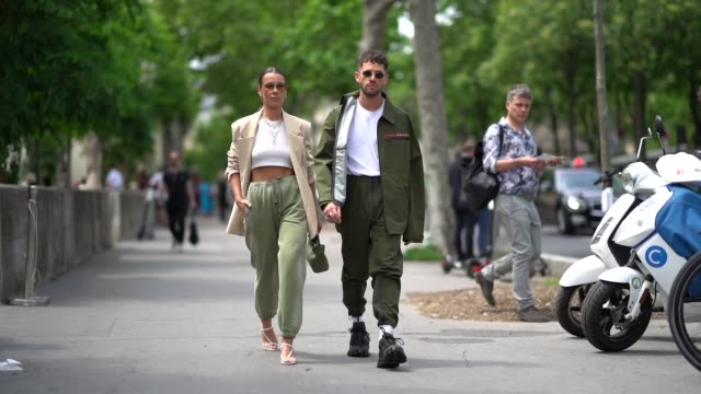 alice barbier wears earrings sunglasses necklaces a white crop top a beige jacket pistachio green pants with a sliding belt and elastic leg hems a... - paris fashion week stock videos & royalty-free footage