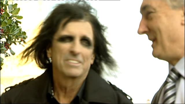 stockvideo's en b-roll-footage met alice cooper visits palace of westminster to promote 'rock the house' campaign; england: london: westminster: ext various of alice cooper shaking... - alice cooper