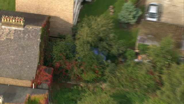aerial views of police search and crime scene england london ealing hanwell police forensic officers searching back garden of arnis zalkalns house - ealing stock videos and b-roll footage