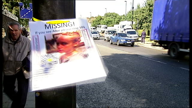 parents' interview / police reconstruction missing poster attached to lamppost as traffic past - missing poster stock videos & royalty-free footage