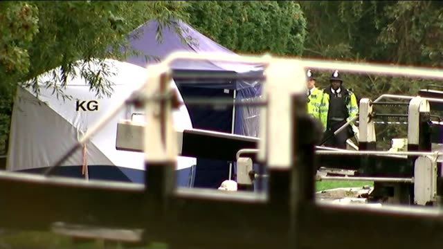 Body found in River Brent Various of police forensics tents and police officers on bank of the River Brent where it converges with the Grand Union...