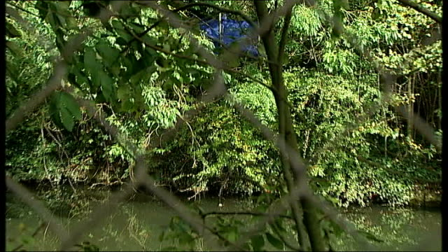 inquest adjourned until new year Hanwell Police forensic tent in undergrowth alongside River Brent