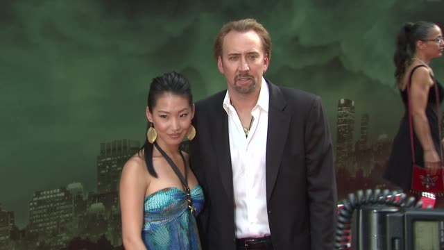 alice kim and nicolas cage at the 'the sorcerer's apprentice' new york premiere arrivals at new york ny - nicolas cage stock videos & royalty-free footage