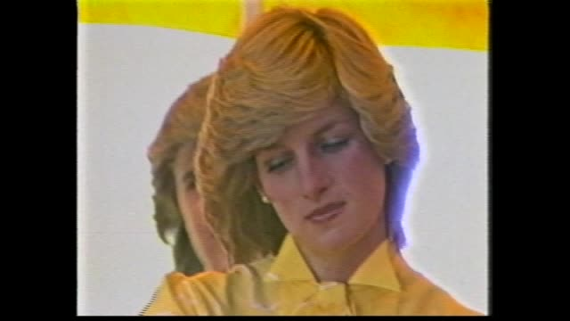stockvideo's en b-roll-footage met prince charles and princess diana onto podium opening of st johns ambulance regional centre / crowd seated outdoors / prince speech / crowd / charles... - 1983