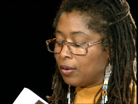 alice walker sitting on high chair and reading from london book:alice walkerback stage with friends and members of hackney of the cast: empire itn... - hackney stock videos & royalty-free footage