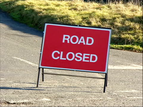 man arrested on suspicion of murder; itn england: devon: dartmoor: ext closed off road where police are searching for body of murdered girl alicia... - road closed sign stock videos & royalty-free footage